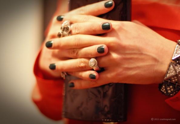 new season fashion chunky bracelet and rings, jade nail polish and orange shirt, styling bright color