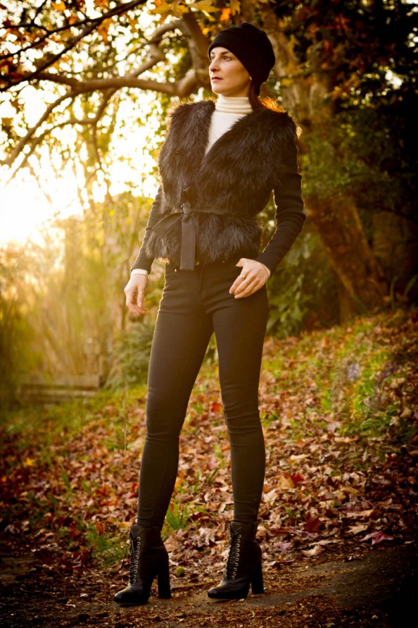 Fur jacket with black skinny jeans and boots for winter