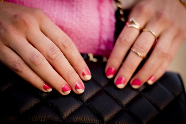dainty stacked gold rings and pink nail art
