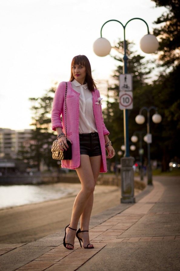 neon pink Zara coat in boucle and short leather shorts