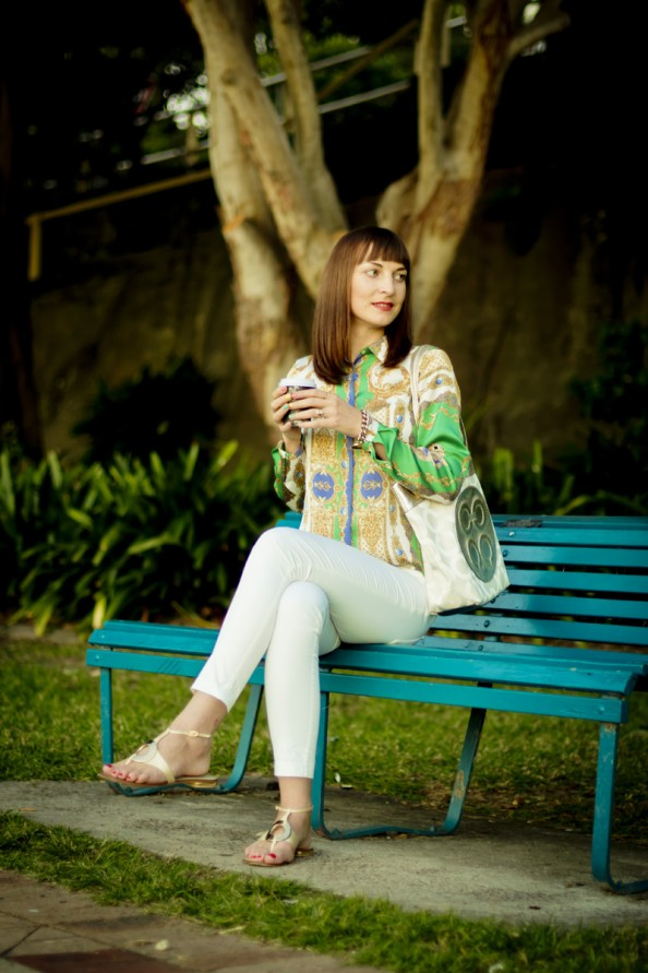 scarf print blouse and white cropped jeans with Coach canvas bag
