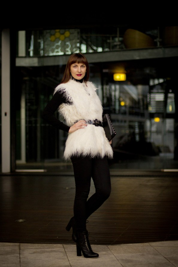 woman in a faux fur vest