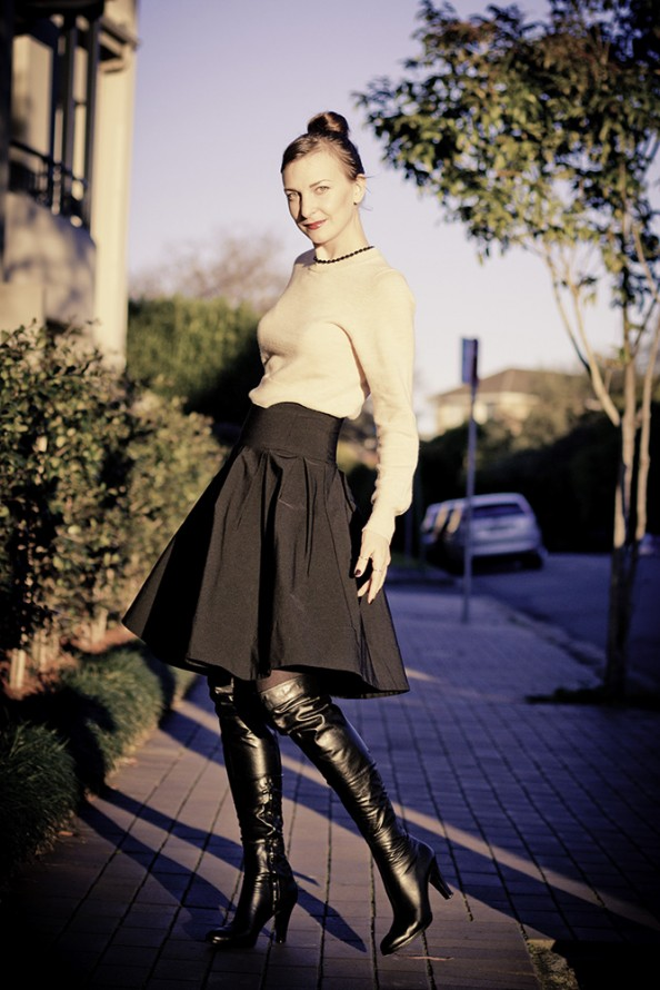 feminine outfit with a high waisted skirt and over the knee boots