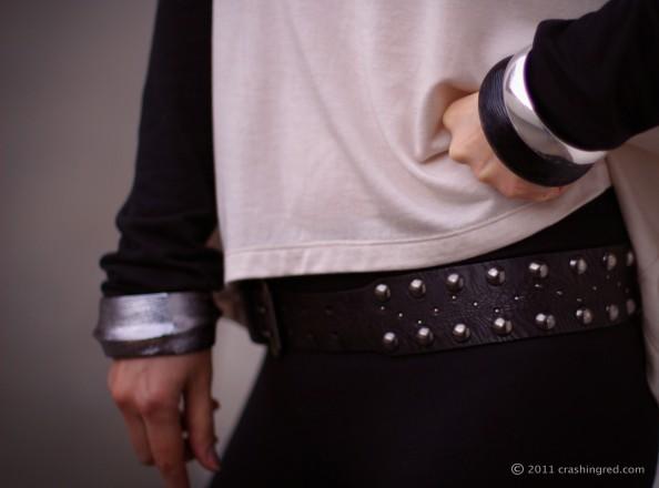 chunky bracelets, black studded belt
