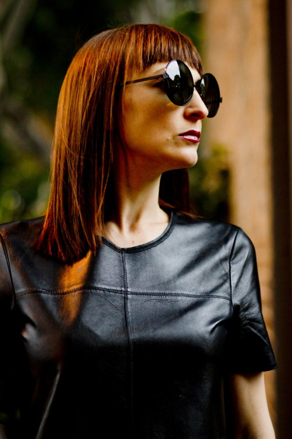 Black leather dress, karen walker sunglasses, how to style leather