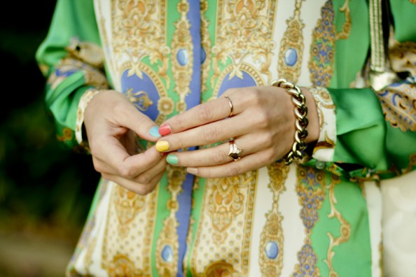 multi colored pastel nails and gold dainty rings