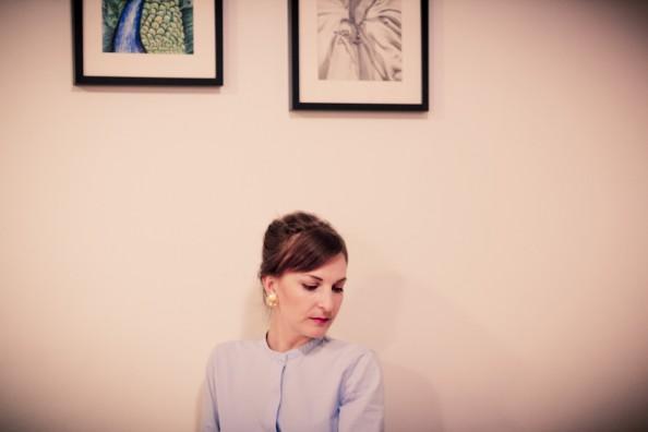 A girl wearing vintage Chanel earrings
