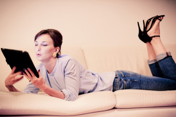 girl with ipod on a couch