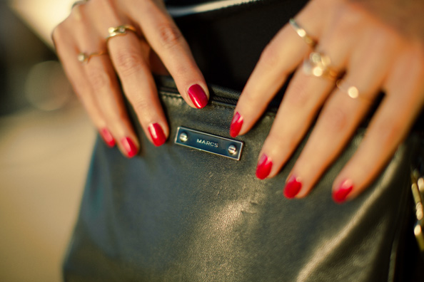red nails gold rings